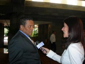 Wendy Saltzman of CBS Atlanta interviews Clayton Chairman Eldrin Bell in lobby of Arizona Biltmore