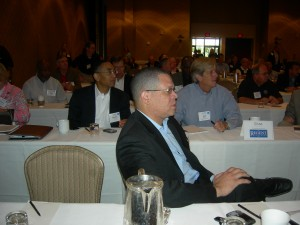 Fulton County Chair John Eaves (center), DeKalb CEO Burrell Ellis and developer Robert Voyles listen to Arizona Senator Russell Pearce