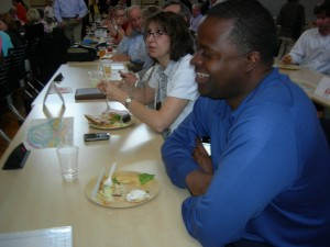 Atlanta Mayor Kasim Reed confers with fellow LUNK delegates