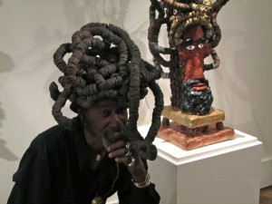 """Gregory Warnack, """"Mr. Imagination,"""" with dreadlocks and a piece of art mimicking that hair style."""