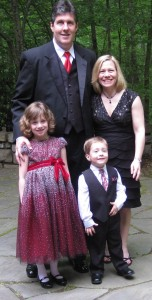 Photo of the Melton family at a wedding in April: Aaron, Staci, Chloe and Charlie.