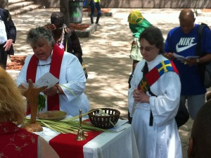Episcopal priest Mary Wetzel and deacon Carole Maddux lead Palm Sunday service in Woodruff Park for homeless and others.