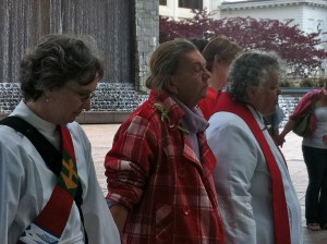 Carole Maddux, left, and Mary Wetzel, right, lead Palm Sunday service in Woodruff Park on April 1.