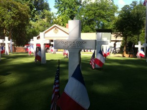 In David T. Maddlone's front yard near Emory University, styrofoam crosses and stars mark the losses of D-Day.