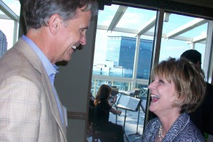 Susan Mendheim shares cheer with Charles Brewer, a Midtown Alliance director and chairman of Charles Brewer Enterprises.