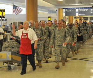 vietnam veteran Tony Hilliard, member of the Atlanta Vietnam Veterans Business Association, volunteers to help troops traveling through Atlanta's airport. Hilliard's group is known for serving hotdogs with chili and all the fixings.