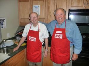 Vietnam veterans George McCoy and Dan Bennett prepare chili dogs